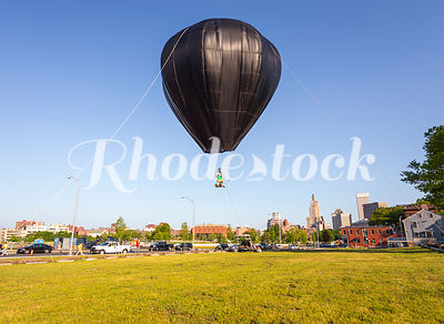 Person flying in a hot air balloon in Providence, RI