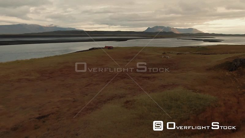 A Fjord and a Black Volcanic Beach in North Iceland