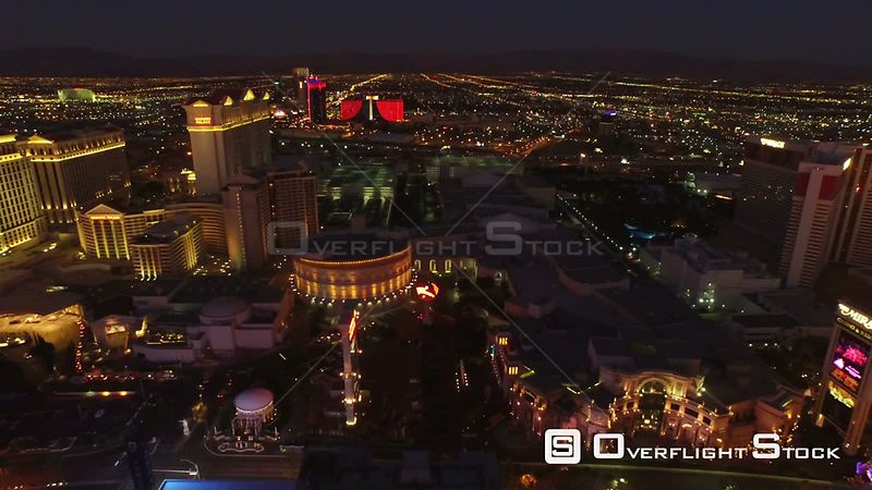 Low flying backwards aerial over strip and high roller Las Vegas Nevada