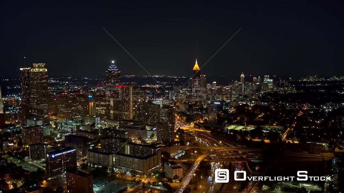 Atlanta Aerial Cityscape hyperlapse crossing high to low with freeway traffic views