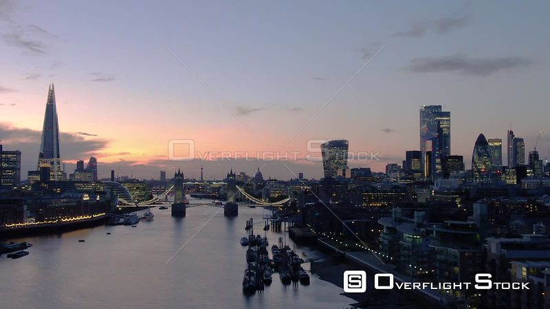 City of London Skyline The Shard and Tower Bridge, filmed by drone in autumn, at dusk, London, United Kingdom