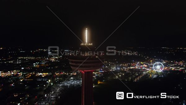 Niagara Falls Ontario Full nighttime panoramic cityscape with Skylon Tower in foreground and Fall views
