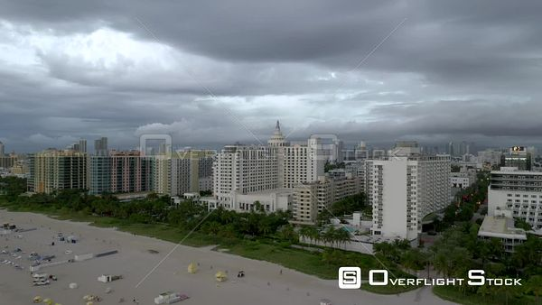 Aerial pull out shot Miami Beach winter scene with overcast clouds