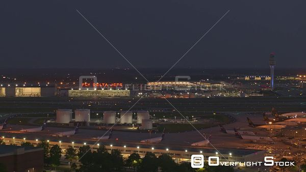 Atlanta Flying parallel with close up view of Delta terminal and runways at dusk night
