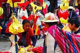 Aymara woman shopping at stall selling red and yellow underwear on New Year's Eve, La Paz, Bolivia