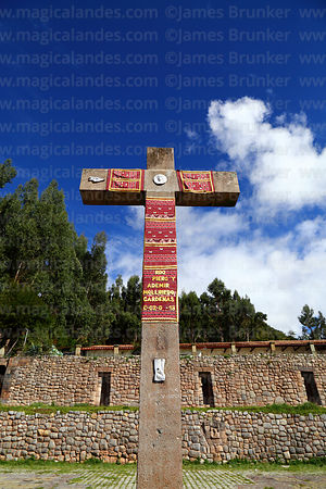 Cruz velakuy cross and Inca stone walls of Manco Capac's palace, San Cristobal, Cusco, Peru