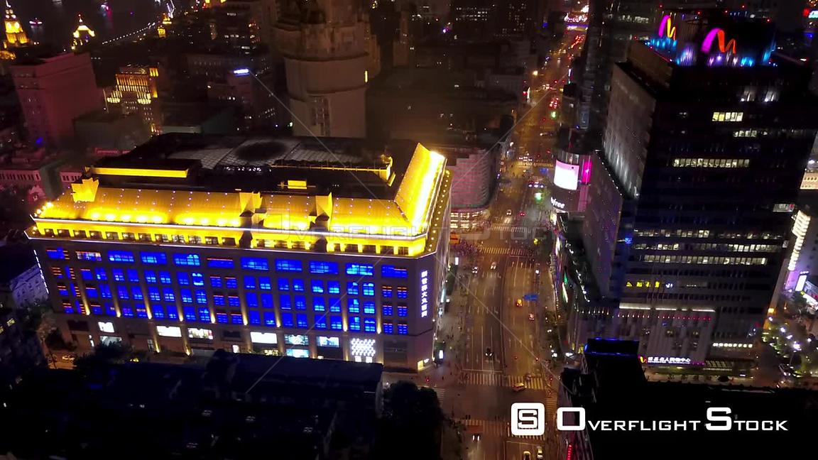 Shanghai  China Shanghai China Aerial Time Lapse Night  Flying birdseye view over famous Bund walking street.