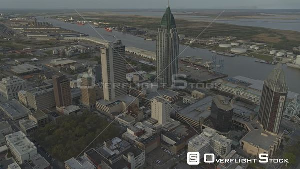 Mobile Alabama Birdseye flying over downtown with cityscape river bay views at susnet