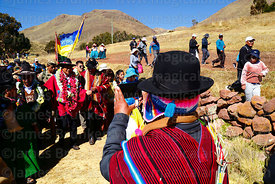 An Aymara man takes a photo of Bolivian president Evo Morales Ayma (centre) with his camera phone as he leads an Internationa...