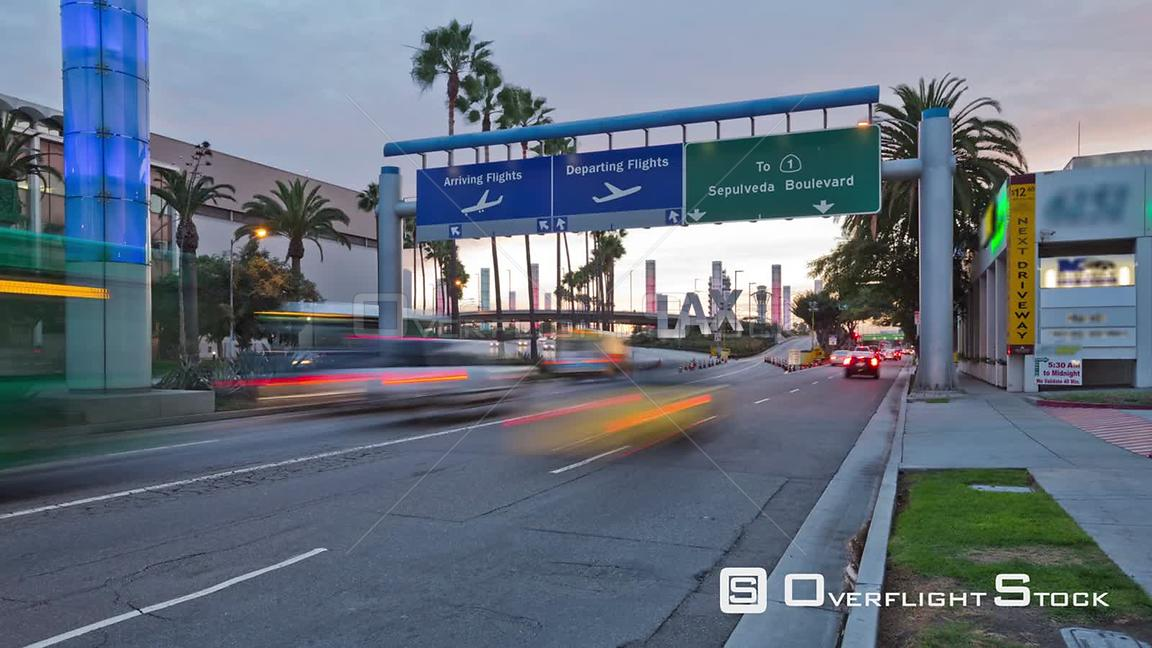 City traffic time lapse at LAX from sunset to night. Los Angeles California
