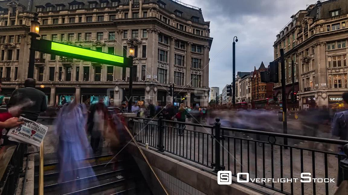 Timelapse view of people rushing at a busy crossroad at a traffic light at Oxford Circus in London