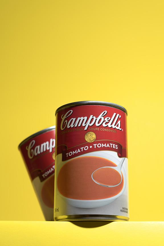Campbell's tomato soup cans on yellow background, Montreal product photographer