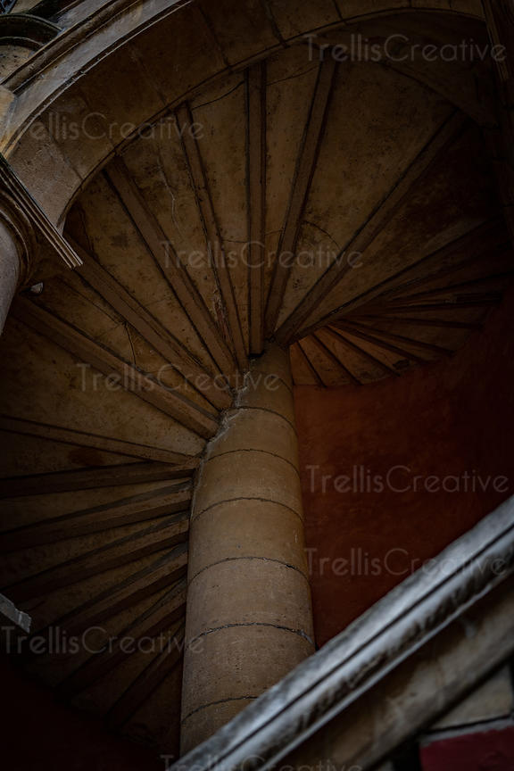 View of spiral stone staircase inside the famous Traboules or secret passageways of Lyon, France