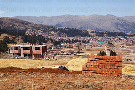 Building under construction at Nuevo Chinchero, near the original village of Chinchero (in background), Cusco Region, Peru