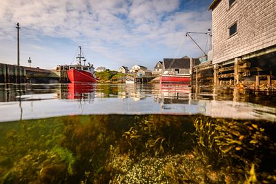 Over under image of Peggy's Cove, Nova Scotia