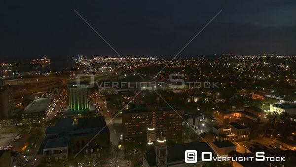 Mobile Alabama panning shot of the downtown skyline at night with streets and buildings  DJI Inspire 2, X7, 6k