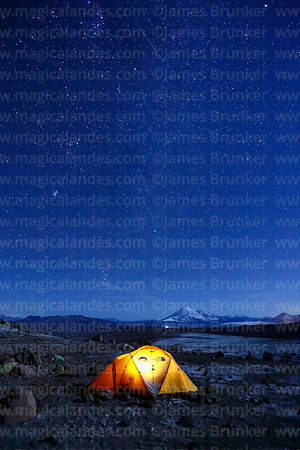 Starry sky above base camp for Guallatiri volcano, Payachatas volcanos in distance, Lauca National Park, Region XV, Chile