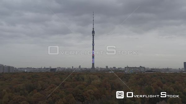 Moscow Teletower at Ostankino Backwards Flight Over the Autumn Park, Lower Altitude. Moscow Russia Drone Video View