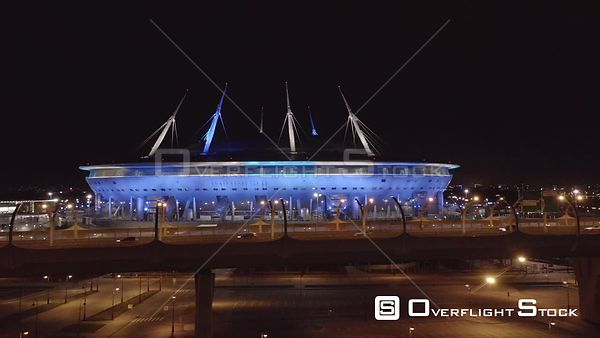 Night Sideway Shot With Road and Zenit Arena Stadium. Saint Petersburg Russia Drone Video View