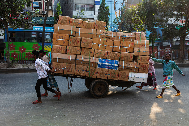 Men Delivering a Load on a Cart