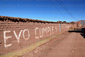 """Evo Cumple"" / ""Evo keeps his word"" painted on adobe wall, Tiwanaku, La Paz Department, Bolivia"
