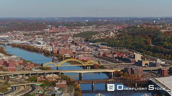 Pittsburgh Pennsylvania Brick red panning birdseye cityscape with river and bridges