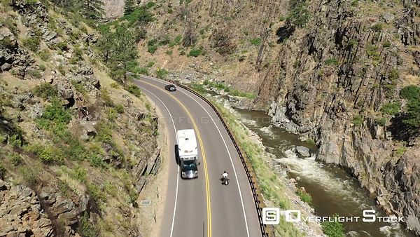 Mountain highway, rushing stream and canyon walls, Loveland, Colorado, USA