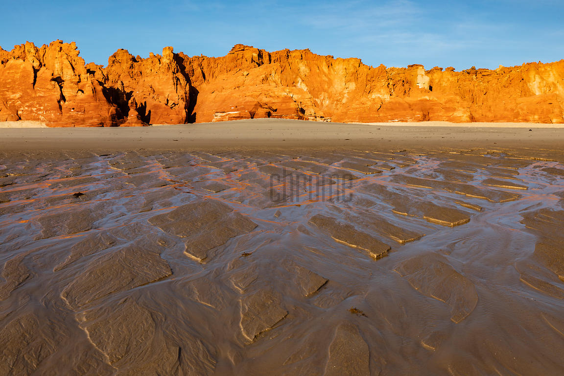 Red Sandstone Cliffs Reflected in Tidal Runoff