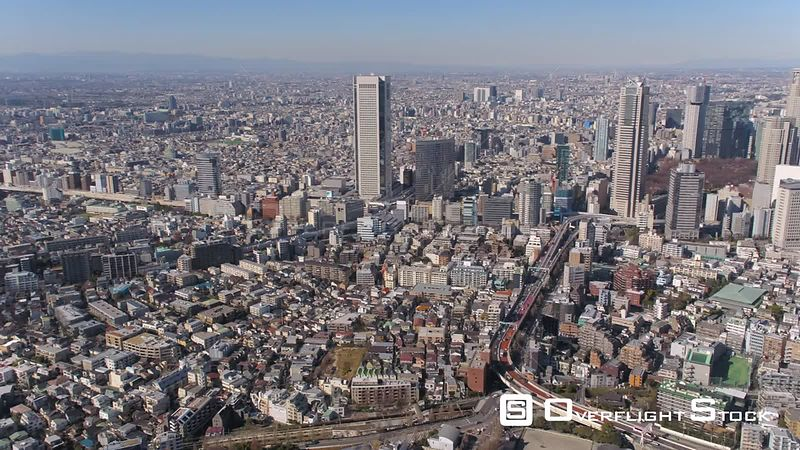 Japan Tokyo Aerial Flying around clock tower with cityscape views sunset Mount Fuji