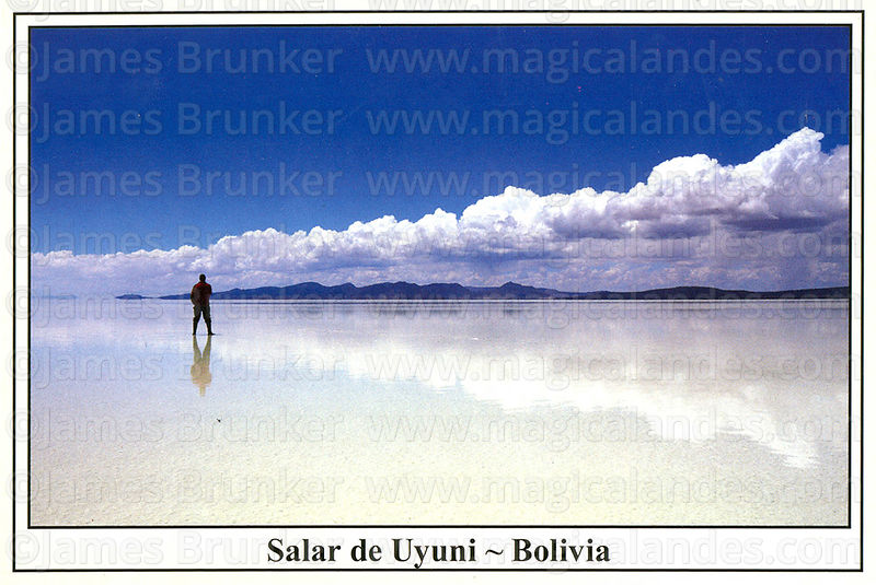 #320 Tourist admiring cloud reflections on the surface of the Salar de Uyuni in the rainy season