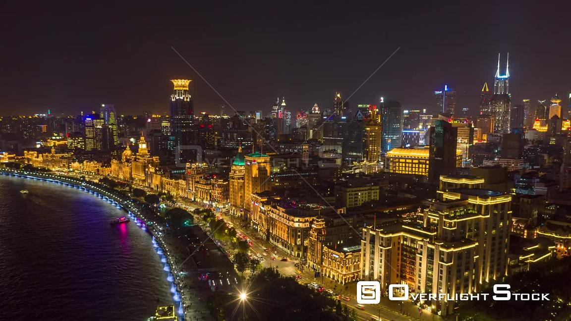 China Shanghai Aerial Hyperlapse at night, birdseye high to low over river to cityscape views