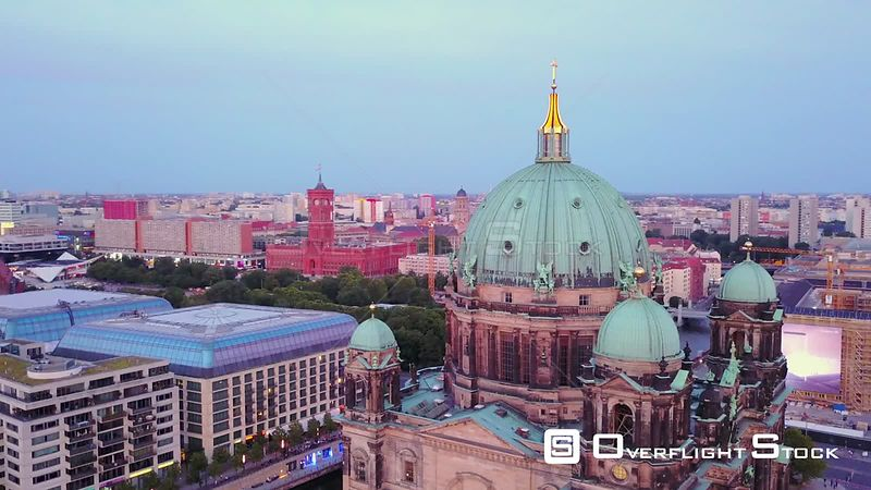 Germany Berlin Aerial Flying low around Cathedral Church building cityscape dusk