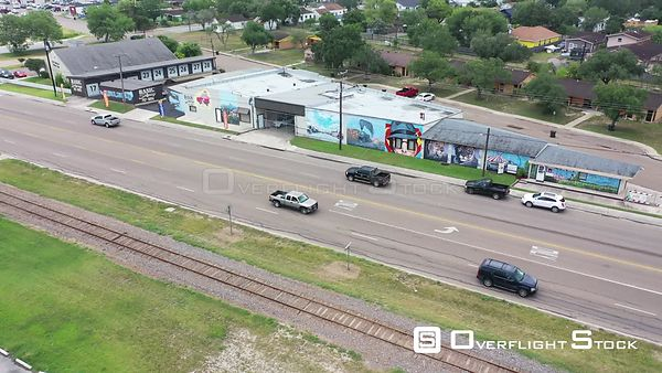 Building murals, low overflight of residential area, La Feria, TX, USA