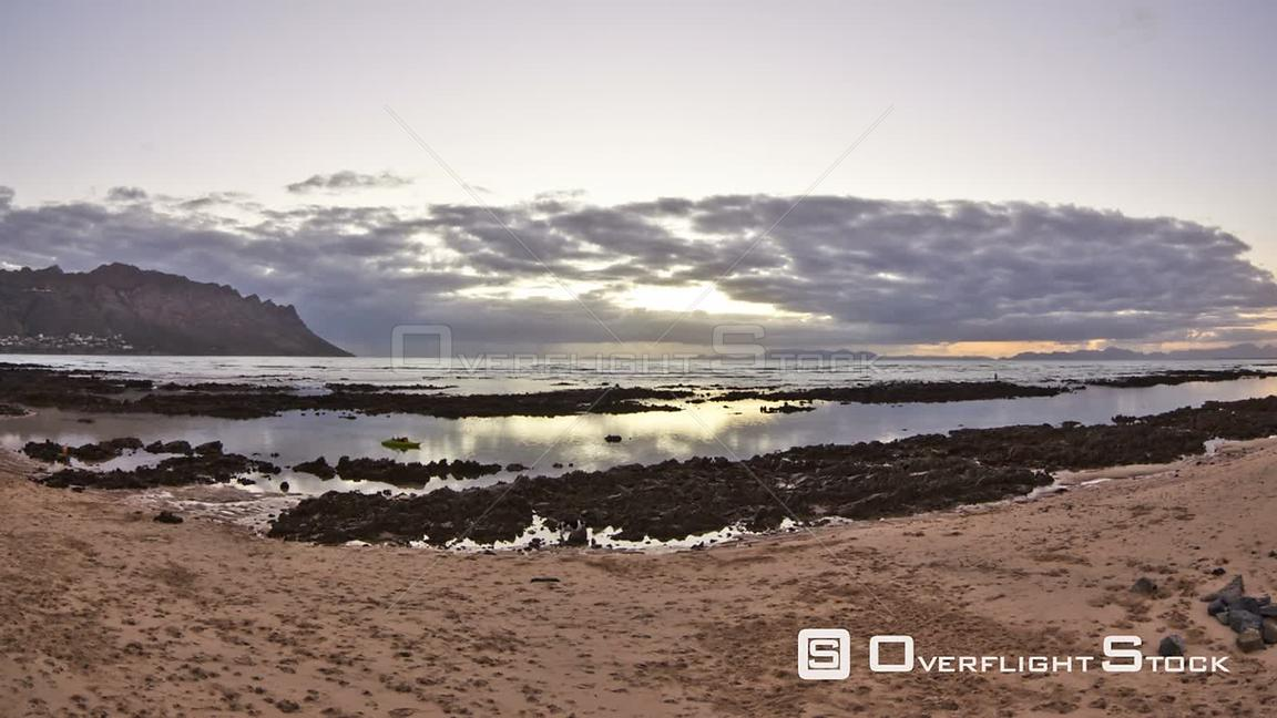 Beach time lapse clip during sunset near Cape Town in South Africa.