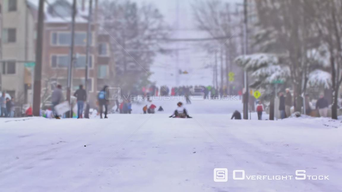 Seattle Washington State USA Three clips of time lapse of people sledding down hill in Seattle.