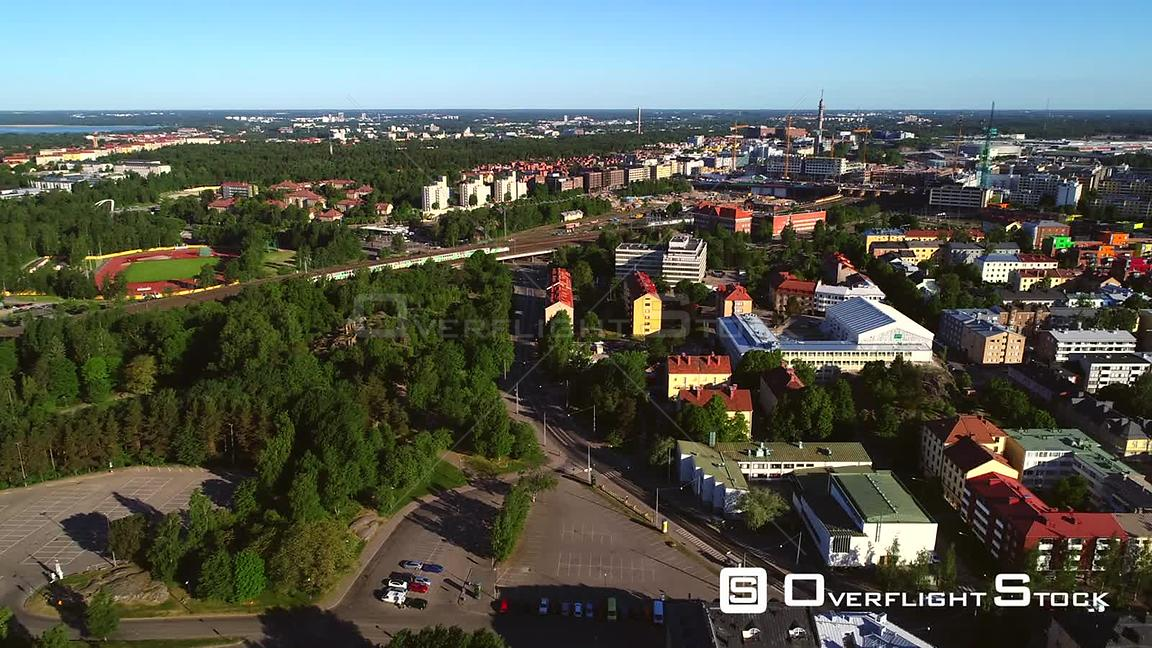 Helsinki city, C4k aerial rising view of alppila and pasila areas, on a sunny summer morning dawn, in Helsingfors, Uusimaa, F...