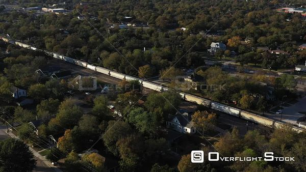 Freight Train Moving Through a Residential Neighborhood, Bryan, Texas, USA