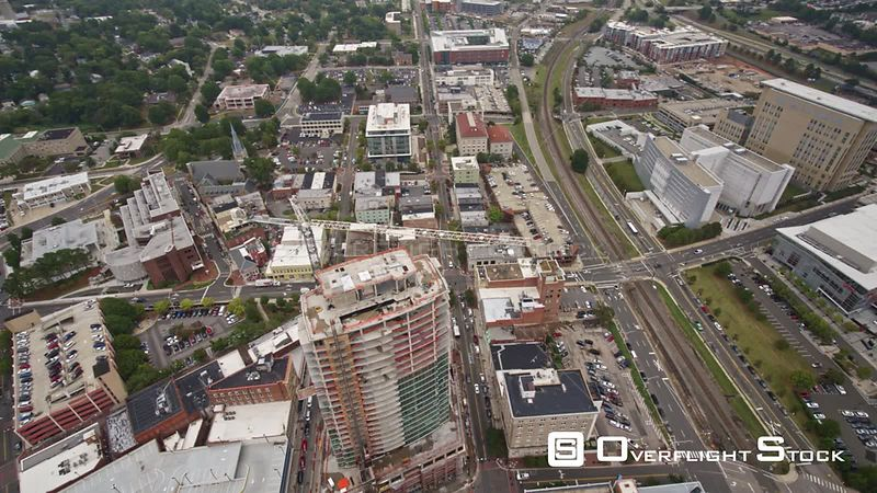 North Carolina Durham Aerial Panning birdseye overtop construction with city views