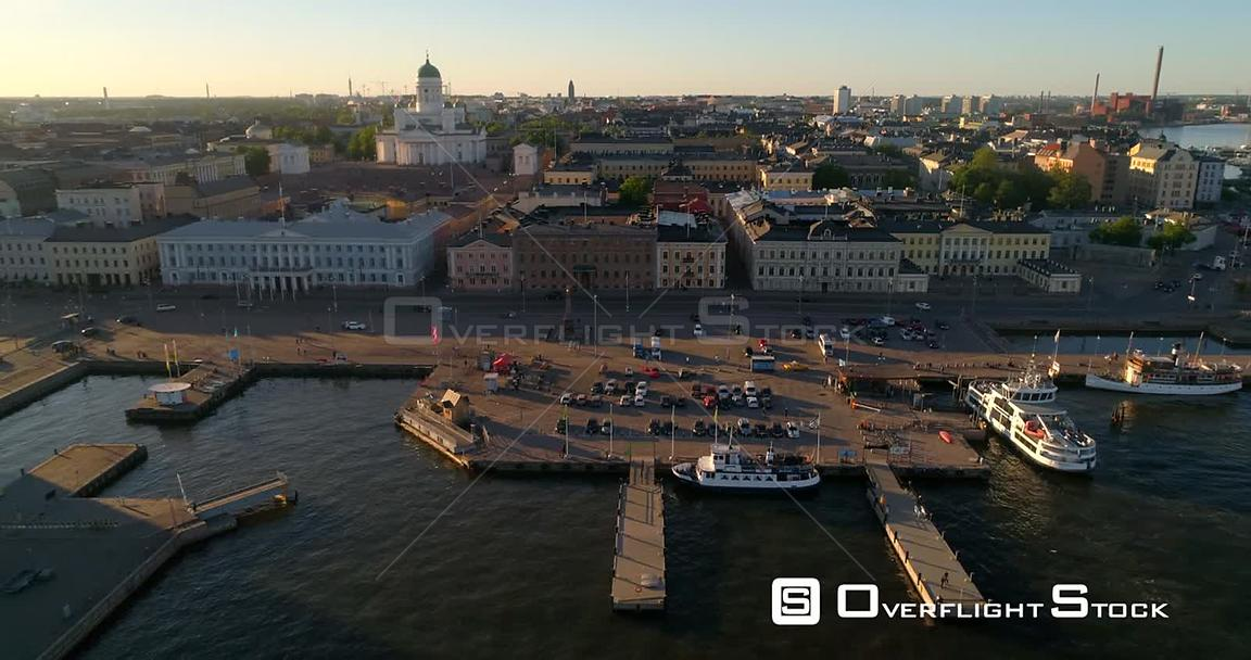 Helsinki market square, C4K aerial sideway view of the Helsinki cathedral and the city, on a sunny summer evening dusk, in He...