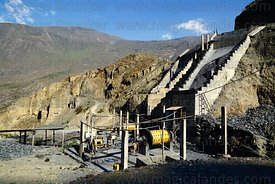 Cylindrical rock crusher below mineral chute in cooperative gold mining settlement of Soamani, near Aucapata, La Paz Departme...