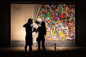 "Martin Whatson's ""Behind The Curtain"" with Viewers in Silhouette"