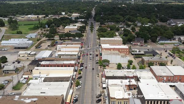 Traffic in a small town downtown, Navasota, Texas, USA