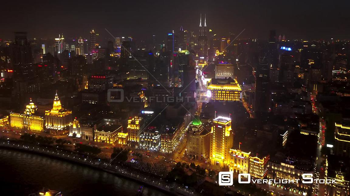 Shanghai  China Shanghai China Aerial Time Lapse Night  Flying along river with busy cityscape views.