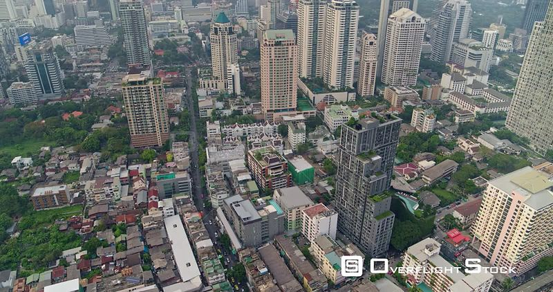 Thailand Bangkok Aerial Birdseye to vertical of Thung Maha Mek cityscape to rooftop view