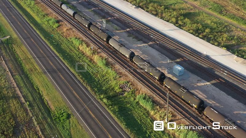 Railroad tank cars traveling down the tracks, Mumford, Texas, USA
