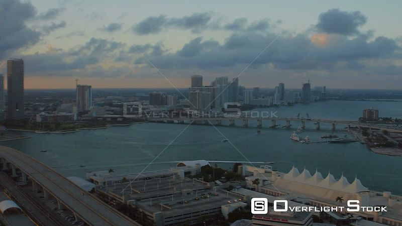 Miami Florida Flying over Dodge Island panning with cityscape views at sunset.