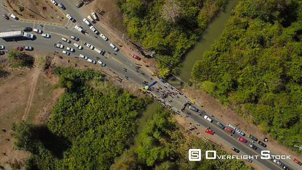 Vertical shot looking down over local town protest blocking traffic over bridge. Costa Rica