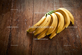 Banana Bunch on a rustic wooden background