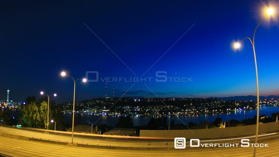 Seattle Washington State USA Panning clip of Seattle I5 traffic time lapse with cityscape in background at duskFisheye lens u...