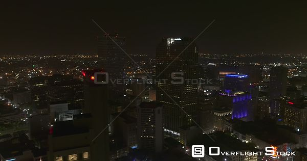 New Orleans Louisiana Aerial Flying around, to reverse in vertical of downtown at night